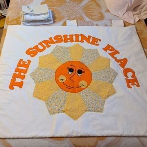 Quilted sun fabric wall hanging